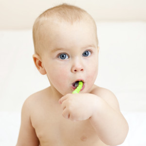 New ADA recommendations suggest brushing your infant's baby teeth with a smear of fluoride toothpaste.