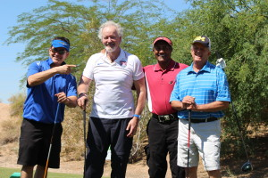 Dr. Brien Harvey and his foursome pose for a picture during the tournament.