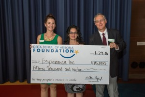 Esperanca's McKenzie Simmons, director of development, and Maria Valenzuela, community health coordinator, accept a $15,000 grant from Delta Dental of Arizona Foundation board member, Dr. Phil Santucci.